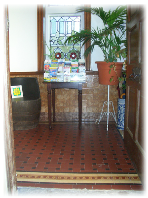 Entrance hall, ½ barrel seat and local information table